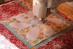 free motion quilting with freezer paper template.