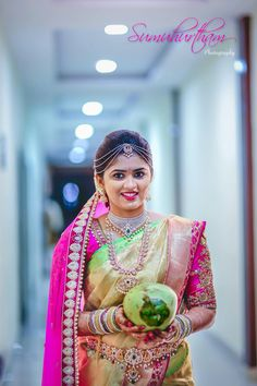 South Indian bride. Diamond Indian bridal jewelry. Temple jewelry.Jhumkis.Pink and cream Kanchipuram silk saree.Braid with fresh flowers. Tamil bride. Telugu bride. Kannada bride. Hindu bride. Malayalee bride.Kerala bride.South Indian wedding.