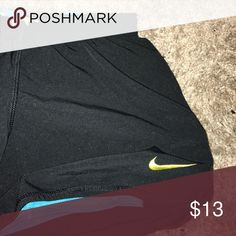 Black Nike shorts Shorts in great shape. Initials are written on the inside but not noticeable when worn. Built in spanx are aqua blue Nike Shorts
