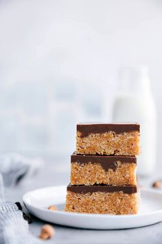 The BEST EVER easy scotcheroos! Every-time I make these bars people ask for the recipe! Not only are they so delicious (and addicting) they are also so quick and easy to make.