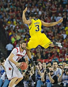 Louisville 82, Michigan 76  Trey Burke picked up his second foul with 11:09 left in the first half and played only six minutes before the break.