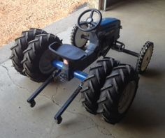 Pedal Pull Tractor. I wonder how fast you've got to pedal before you need the wheelie bars?