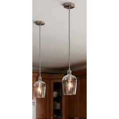 This Allen and Roth vintage inspired mini pendant will add a warm glow to any home decor. It is featured in brushed nickel finish with a clear bell shape glass.