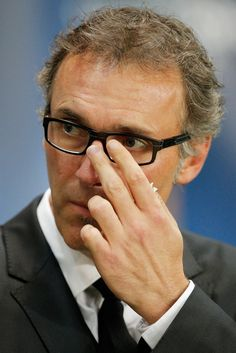 PSG Head Coach / manager, Laurent Blanc looks on prior to the Group F UEFA Champions League match between Paris Saint-Germain v FC Barcelona held at Parc des Princes on September 30, 2014 in Paris, France.