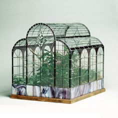 First created (accidentally) by Nathaniel Ward in the mid-1800s, terrariums became incredibly popular in the Victorian era as an opportunity for folly, experimentation, craft, and art. Ward's original terrariums were closed ecological systems, enlivened with constant cycles of evaporation and watering. The delicate balance of the closed system was suited to the delicate design of Wardian terrarium cases, which look like glass-enclosed birdhouses.