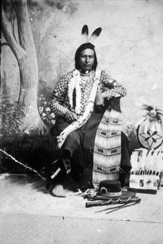 Cayuse/Nez Perce Man Known As Tauitau Or Tu Ah Tway Poses With Headdress And Other Beaded Objects. American Indians Of The Pacific Northwest.