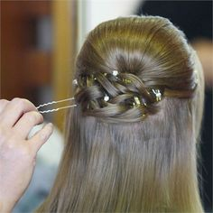 like a Celtic knot? but incorporated into an up-do?