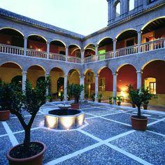 Beautiful courtyard at the Palacio de Santa Paula in Granada, Spain