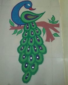 Make these beautiful Peacock Rangoli Designs for Diwali. You can also make these freehand, simple Peacock Rangoli Designs for competition and for new year. Rangoli Designs Peacock, Very Easy Rangoli Designs, Rangoli Patterns, Free Hand Rangoli Design, Small Rangoli Design, Rangoli Border Designs, Rangoli Ideas, Rangoli Designs Diwali, Diwali Rangoli