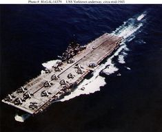 USS Yorktown underway circa possibly during her shakedown cruise in the late spring. Planes on deck include Hellcat fighters and Helldiver scout-bombers. Note this carrier's unique longitudinal black flight deck stripe. Us Navy Aircraft, Navy Aircraft Carrier, Essex Class, American Aircraft Carriers, Grumman F6f Hellcat, Uss Yorktown, Us Navy Ships, Flight Deck, Fighter Aircraft