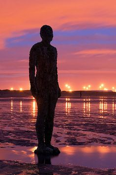 Antony Gormley's installation Another Place on Crosby Beach in Liverpool