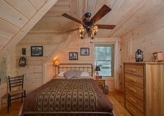 Cozy bedroom decor in a classic Deep Creek Lake log cabin
