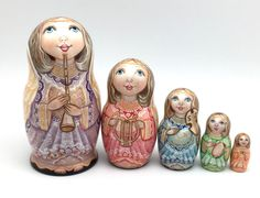 "Russian nesting doll (stacking doll) or Matryoshka doll is a set of dolls decreasing in sizes placed one inside another. The word ""ma-tr-o-sh-ka"" is related to the old Russian word mat, meaning ""mother"". 