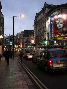 View of London's West End theatres in Soho's Shaftsbury Avenue, with giant Les Miserables poster over Gielgud Theater - London
