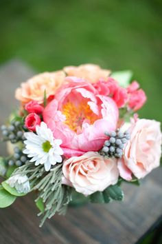Cheerful bouquet with a huge pink peony in the center