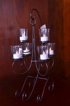 six candle holder, $21.00. 2 available