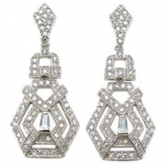 Clear cubic zirconia stones in baguette and round cuts adorn these antique-style pave earrings from Plutus. These earrings are fashioned of .925 sterling silver with rhodium plating for longer durabil