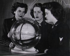 """In 1944, the Navy began a new specialty: celestial navigation for Link trainer instructors. The 10-week course was held at the NAS Seattle, Washington.  In this photo, Ruthe Ingerslew, Patricia Baldwin, and Sally King study the earth's rotation to, as the Navy put it, """"the celestial sphere"""" (aka the stars).  It comes from the National Archives and is curated by Homefront Heroines: The WAVES of World War II.  www.hingesofhistory.com"""