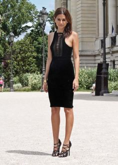 Love the leather laced-up detail on the chest of this black dress worn by #ChristineCentenera.