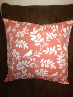 Pillow cover, White bird on twig pattern, with a light, but rich, coral colored background. $25.00, via Etsy.