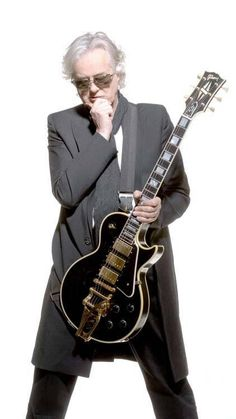 Jimmy Page with his namesake Les Paul Custom with Bigsby that Gibson based on the 1960 Les Paul Black Beauty stolen from Page in 1970 and never recovered.