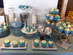 Candy bar for a baby baptism .all sweets in baby blue themed candy bar.cupcakes and cakepops
