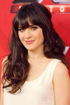 The Evolution of the Bang from Bettie to Zooey Beautiful Bangs Icon 2011: Zooey Deschanel - Elle Magazine