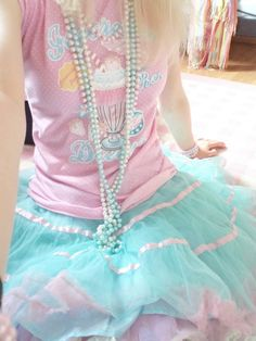 Necklaces and skirt also a nice pastel matching shirt! I want this for myself too!