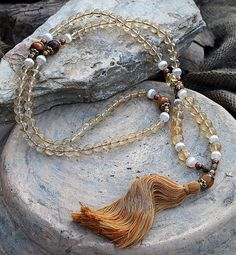 Mala made of 8 and 10 mm - 0.315 and 0.394 inch citrine and 8 mm - 0.315 inch Tibetan style agate gemstones. Together they count as 108 beads - look4treasures on Etsy
