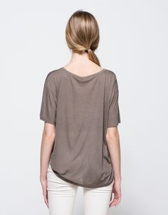 From Baserange, a classic, lightweight tee in taupe. Features a wide rounded neckline, ribbed neckline, short sleeve, heather fabric, slightly sheer finish and relaxed fit throughout the body.  •	Lightweight tee in taupe •	Wide rounded neckline •	Ribb