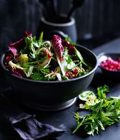 Australian Gourmet Traveller recipe for mixed tender leaf salad with pomegranate and walnuts.