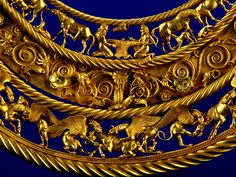 Gold Scythian neckpiece, from royalty, 2nd half of the 4th century BC. The central lower tier shows three horses, each being torn apart by two griffins. Badassery.