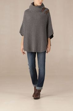 knit cape - like the fastenings at the shoulder