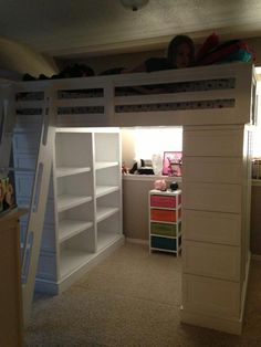 Full sized Loft bed in white.  This photo shows the side opposite the dresser is a double bookcase.