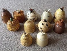 ≗ The Bee's Reverie ≗ vintage collection of honey pots :-). Have the one on far left. Anyone know how old it is?