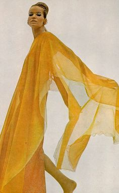 Veruschka in a silk chiffon poncho in lengths of orange and yellow by Stavropoulos, photo by Bert Stern, Vogue US 1966