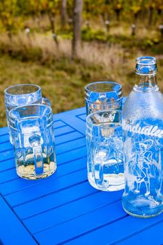 Blue table with the Austrian Almdudler soft drink at Heurigen Wailand in the Vienna Woods vineyards at Kahlenberg. Vienna Woods, Soft Drink, Wine Glass, Mason Jars, Vineyard, Beer, Mugs, Table, Ale