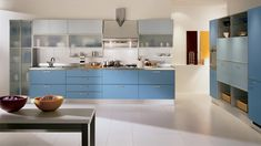 Kitchen cabinets storage with stylish shapes and colors #kitchen ideas #kitchen cabinets design kitchen cabinets design with blue color kitchen cabinets design with nature kitchen cabinets design with orange color
