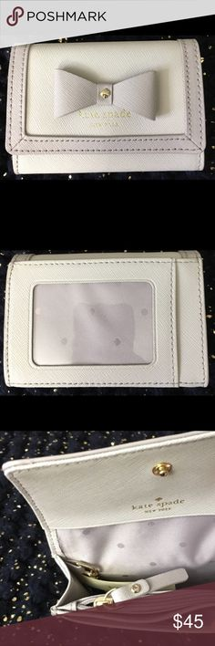 NWT Kate Spade Darla wallet NWT Kate Spade Darla wallet brand. New with rags. Has a key chain attach to it and clear ID spot. I purchased but not the right one I wanted. All offers are considered. kate spade Accessories Key & Card Holders