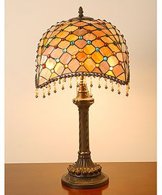 @Overstock - This elegant Amber Table Lamp has been handcrafted using methods first developed by Louis Comfort Tiffany.http://www.overstock.com/Home-Garden/Tiffany-style-Amber-Beaded-Table-Lamp/1891942/product.html?CID=214117 $119.43