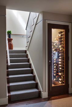 Beachfront property in Massachusetts showcases a stylish renovation - Wine cellar under stairs -