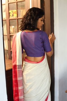 Red quilting on an ink blue blouse with a button down back. An outfit for a muse. THE KAITHARI PROJECT Pioneer Women Collection Handwoven, designed and tailored in Kerala Saree Blouse Patterns, Sari Blouse Designs, Fancy Blouse Designs, Lehenga Pattern, Collar Designs, Dress Designs, Sleeve Designs, Shirt Designs, Saris