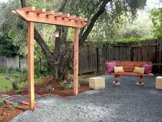 DIY Garden Arbor- instructions included. Would be nice to add privacy between neighbors and put plants under it.