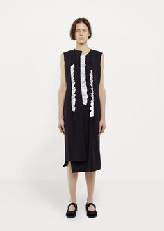 Spring Summer '17 Runway /  Navy sleeveless midi dress with contrasting white cotton ruffle detail at front and back. Relaxed straight fit. Raw undone edges at