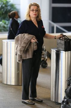 Catherine Deneuve Photos Photos: Catherine Deneuve Arrives at LAX Catherine Deneuve Photos - French actress Catherine Deneuve arriving on a flight at LAX airport in Los Angeles, California on February Catherine rushed out for the airport so she co Catherine Deneuve, Airport Outfit Long Flight, February 3, Long Flights, Ageless Beauty, French Actress, Then And Now, Actresses, Miraculous