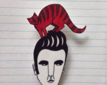 Morrissey and cat brooch.