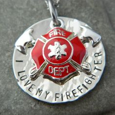 I love My Firefighter Necklace with Axe Shield....I want one of these!