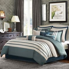 Outfit your guest room or master suite in resort-worthy style with this lovely comforter set, showcasing a stripe motif and complementing accent pillows.
