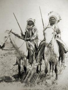 Assiniboine Indians warriors.