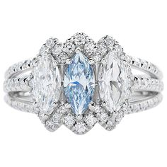 Rare GIA Cert 0.44ct Marquise Shaped Fancy Blue Diamond Three Stone Ring | From a unique collection of vintage engagement rings at https://www.1stdibs.com/jewelry/rings/engagement-rings/